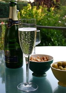 220px-Champagne_flute_and_bottle